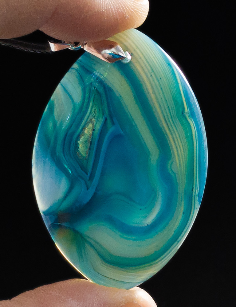 Blue Striped Agate Pendant Stone - backlit view