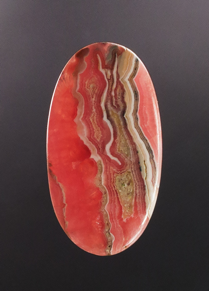 Lovely Rhodochrosite Cabochon, 53x29x5mm, 81 cts - semi-backit view