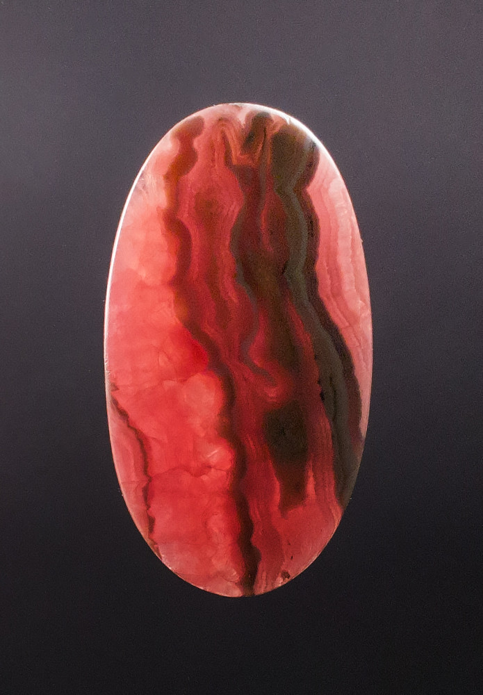 Lovely Rhodochrosite Cabochon, 53x29x5mm, 81 cts - backlit view