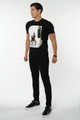 August McGregor Rumble Rumble Crewneck Cotton T-Shirt in Black with portrait of Conor after an intense training session.