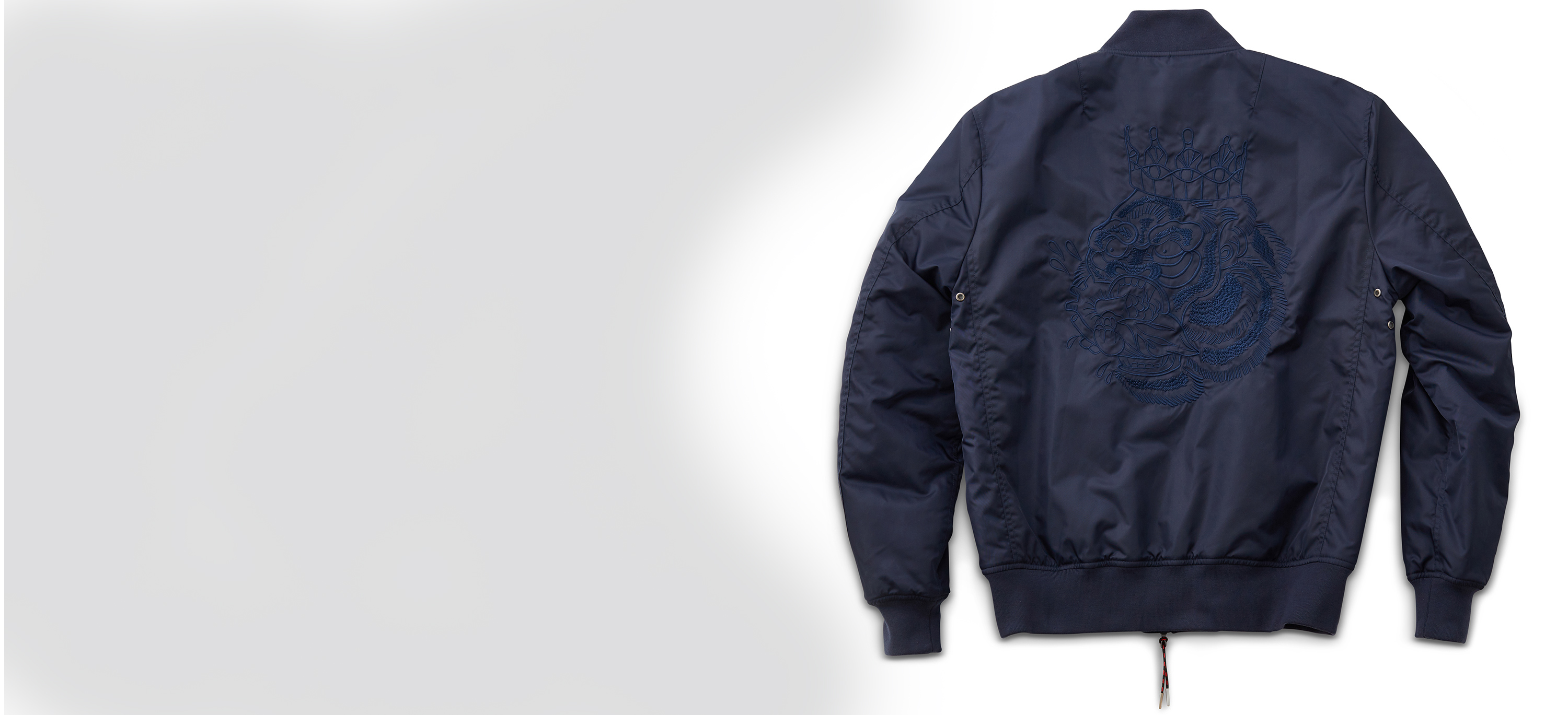 Product image of Navy Nylon Bomber Jacket with embroidered Blood Hungry Gorilla in tonal stitch on back.