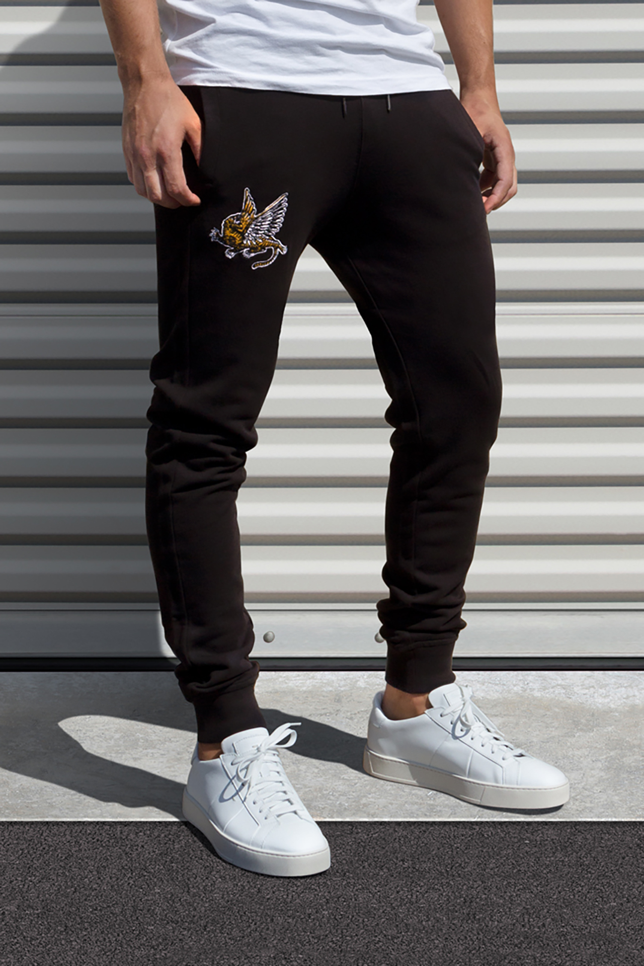 AM X PRPS Embroidered Flying Tiger Jogger Sweatpants in Black