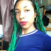 Cheyenne wearing braids in Emerald Green and Black Orchid