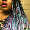 Andrea wearing braids made from IKS kk jumbo braid in Lavish Purple, Light Blue, Medium Purple, Neon Violet, Orchid, Polar Blue, and Powder Pink
