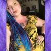 Jill wearing braids in Dark Purple, Medium Purple, Purple, and Turquoise