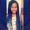 Tavi wearing Midnight Blue braids