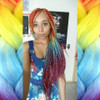 Yvette wearing braids in Vibrant Rainbow