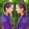 Vibrant Rainbow braids by Wandering Hair Designs