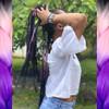 Lexi wearing braids made from Dream Festival Braid