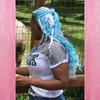 Jawaya wearing Glow Pastel neon box braid, glow in the dark braiding hair, high heat kk in Light Pink,  and kk jumbo braid in Periwinkle and Sky Blue