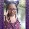 Christina wearing marley braid in 1B Off Black with Dark Purple Tips