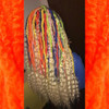 Faux locs using Red, Orange, Yellow, Neon Lemon Lime, Navy Blue, and Powder Pink marley braid, installed by Bre'Shell