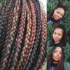 Leesa wearing 4 Dark Brown, 33 Dark Auburn, and 130 Red Auburn kk jumbo braid