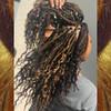 Katira wearing braids made from FS27/30/33 Caramel Mix