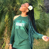 Alexia wearing braids made from Off Black with Ocean Green Tips