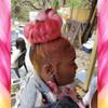Candace wearing a braided bun in Peachy Keen