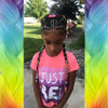 @nett_med's daughter wearing braids in 1B Off Black with Neon Yellow Tips, Peachy Keen, Reverse Rainbow, and Twilight, with faux pearl hair beads down at the ends