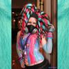 Glow Wurm wearing dreads made from Sky Blue, Neon Magenta, and 1 Black kk jumbo braid