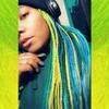 Hen wearing braids in Bright Petrol Green, Cobalt Blue, Jungle Green, Lemon Lime Ombré, Light Petrol Green, and Seafoam Green