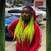 cutielee._ wearing braids in 1B Off Black with Neon Yellow Tips
