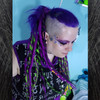 Amber Blue wearing synthetic dreads made from kanekalon in 1 Black, Neon Lemon Lime, and Neon Purple