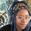 Sydni wearing braids in Blue Teal