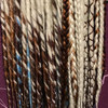 Synthetic dreads made by Black_Bat_Boutique in 1001/613 Creamy Blond, 1B Off Black/Orange Mix, 130 Red Auburn, 35 Bright Auburn, Amber, and Light Blue