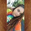 Taylor in braids made from a mix of Amber, 130 Red Auburn, 35 Bright Auburn, and 350 Rusty Red