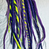 Synthetic dreads made by Amber Blue in Muted Purple, Space Cadet, and Neon Lemon Lime
