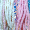 Synth dreads made by RoboKitty in White Cotton Candy and Pink Cotton Candy.