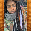 Tamoiya wearing twists made from 27/613 Mixed Blond and Amber marley braid