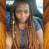 Tamoiya wearing braids in T4/AM Dark Brown with Amber Tips