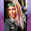 Caitlin wearing synthetic dreads in Icy Blue, Lime Delight,  Bright Lilac, Candyfloss, Light Denim, and Mojito