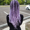 Mind Games wearing braids in Icy Blue and Lilac Ombré