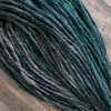 Synthetic dreads made by Amber in 1 Black, 51 Grey, and Light Pine