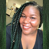 Erica wearing braids in 1B Off Black with Jungle Green Tips