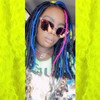 Roshonda wearing Navy Blue, Neon Violet, and Neon Yellow marley braid