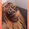 Jamila wearing braids in Sherbert and Sunkiss