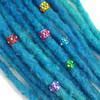 Rainbow rhinestone hair cuffs shown on blue synthetic dreads