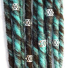 Silver rhinestone hair cuffs shown on brown and blue synthetic dreads
