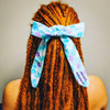 Synthetic dreads by Dreadnaughty, LLC in Amber