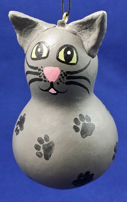 The gray cat has black paw prints all over!