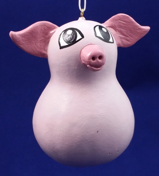 This pink pig will look great hanging on your Christmas tree or in your home year round.