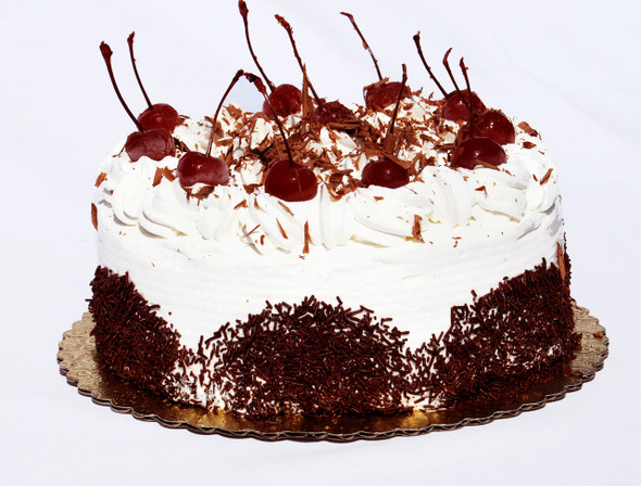 """This is our number selling cake that is perfect for any special occasion! It is always fresh and made!  Our Black Forest Cake is made with moist chocolate cake, rum, imported cherry preserve and whip cream. It is then decorated with whip cream, all-natural cherries and shaved chocolate pieces on top. 8"""" Round Serves 8-10 people"""