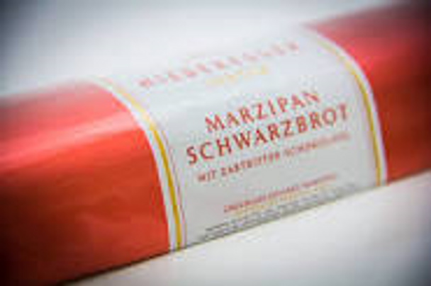 Niederegger - Chocolate Covered Marzipan Loaves This is pure 100% marzipan paste (70% almonds, 30% sugar) covered with bittersweet chocolate in the classic shape. Comes in 1.6 oz, 2.6 oz, 4.4 oz, 7.0oz and 10.5 oz sizes. This is the 4.4oz Chocolate Covered Marizipan Loaf