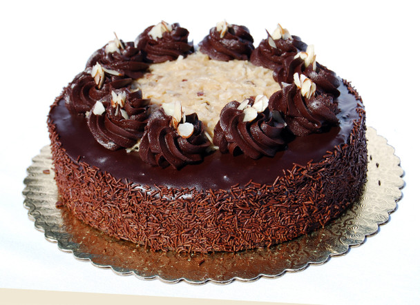 """Originating in the United States, this cake was named after Sam German who developed a formula to bake dark chocolate. This classic cake conisists of moist chocolate cake, layered with pecan and coconut filling, and then poured with rich ganache chocolate. Topped off with pecan and coconut filling. 8"""" Round - Serves 8-10 people"""