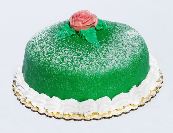 """This delicate Swedish torte is handcrafted in our bakery and is made with the finest ingredients that include moist white cake, raspberry preserve, rich vanilla Bavarian cream and whip cream. This special torte is then wrapped with green marzipan and dusted with powdered sugar on top. 8"""" Round - $23.00 – Serves 8-10 people"""
