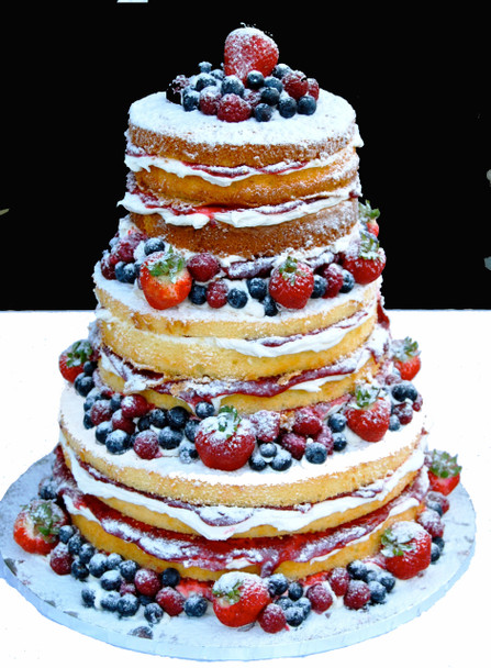 The Un-iced Wedding Cake  This three tiered stacked cake is filled with cream cheese and imported raspberry preserve.For those who prefer a lighter, less sweet dessert, this is perfect for you. The cake is then dusted with powdered sugar and decorated with fresh berries.