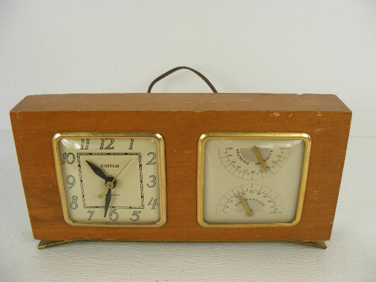 A Vintage Wood Desk Clock With Temperature And Humidity Dials Made