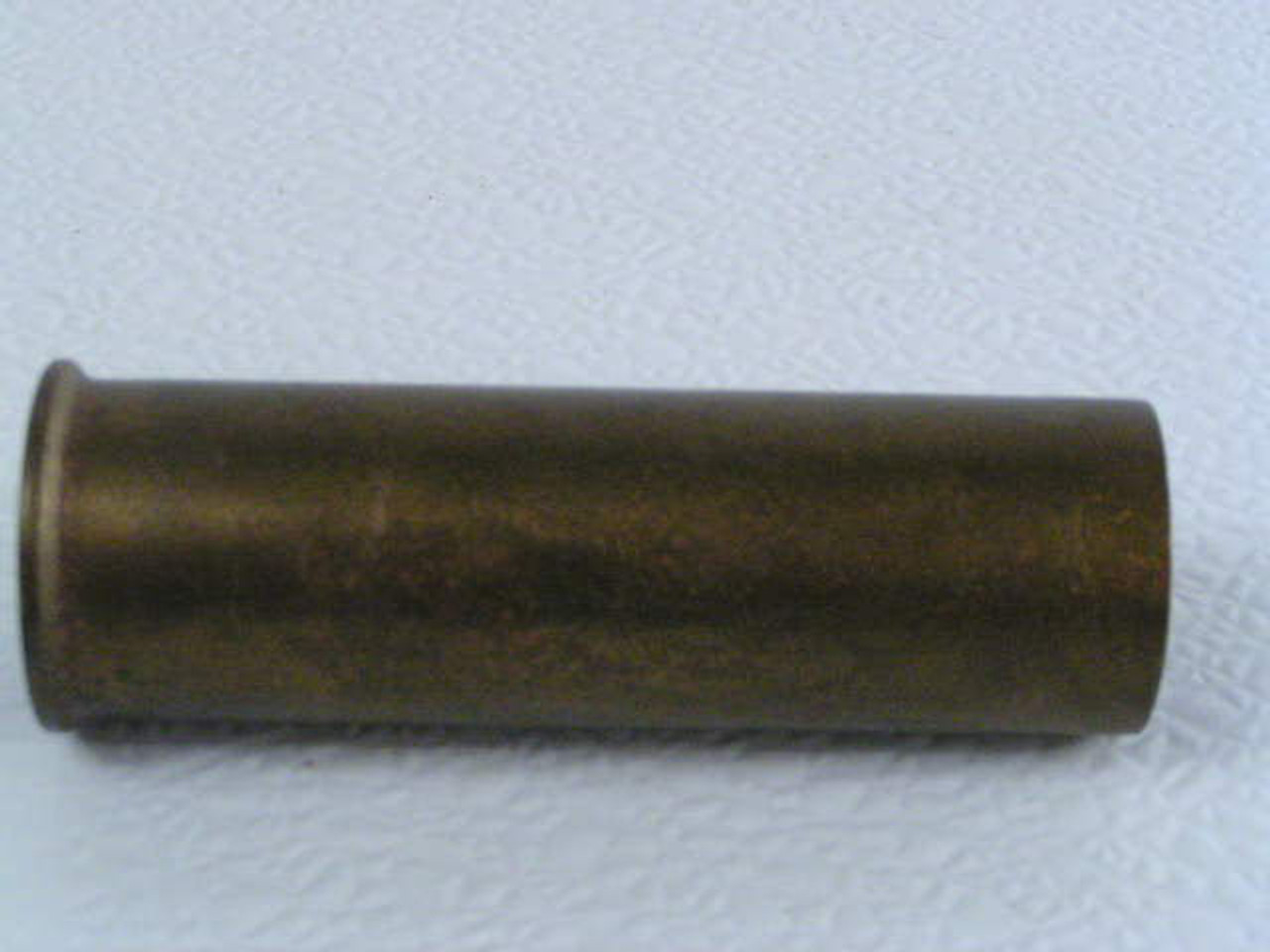 This late 1800s antique shotgun shell brass is in the hard to find 8 gauge  size and was made by Union Metallic Co
